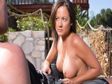 Breasty hottie jerks off outdoors